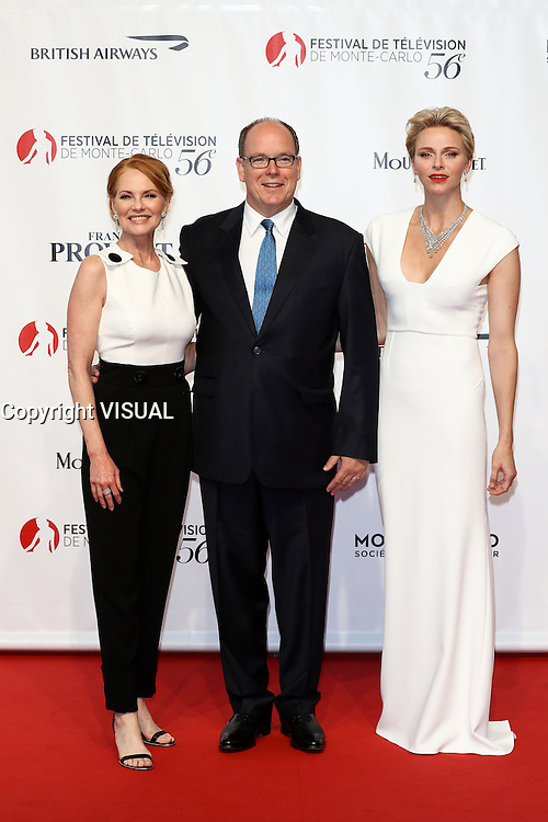 56th Monte-Carlo Television Festival opening red carpet. TT.SS.HH. Prince Albert II and Princess Charlene of Monaco with Marg Helgenberger.