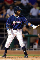 Rey Navarro (8) of the Northwest Arkansas Naturals at bat during a game against the San Antonio Missions at Arvest Ballpark on June 30, 2011 in Springdale, Arkansas. (David Welker / Four Seam Images)