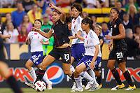 14 MAY 2011: USA Women's National Team forward Alex Morgan (13)  dribbles past Japan National team Rumi Utsugi during the International Friendly soccer match between Japan WNT vs USA WNT at Crew Stadium in Columbus, Ohio.