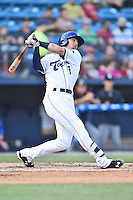 Asheville Tourists second baseman Forrest Wall (7) hits a home run during a game against the Kannapolis Intimidatorson May 19, 2015 in Asheville, North Carolina. The Tourists defeated the Intimidators 7-3. (Tony Farlow/Four Seam Images)