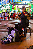 Street Musician at Nighttime Flea Market, Ipoh, Malaysia.
