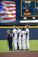 Michigan Wolverines infielders Blake Nelson (10), Jack Blomgren (2), Ako Thomas (4) and Jimmy Kerr (15) stand for the national anthem before the NCAA baseball game against the Michigan State Spartans on May 7, 2019 at Ray Fisher Stadium in Ann Arbor, Michigan. Michigan defeated Michigan State 7-0. (Andrew Woolley/Four Seam Images)