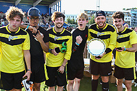 London, UK on Sunday 31st August, 2014. James Arthur (2nd Right) with the Plate Trophy during the Soccer Six charity celebrity football tournament at Mile End Stadium, London.