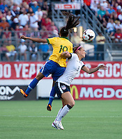 Kristie Mewis (8) of the USWNT collides with Raquel (19) of Brazil during an international friendly at the Florida Citrus Bowl in Orlando, FL.  The USWNT defeated Brazil, 4-1.