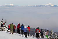 Skiers on Gore revel in a rare above the clouds view of the Adirondack High Peaks.