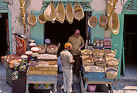 Tunisia.  Tunis Medina.  Vendor of Nuts, Baskets, and Drums, opposite the Zeituna Mosque.