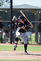 Chicago White Sox catcher Evan Skoug (27) at bat during an Instructional League game against the Kansas City Royals at Camelback Ranch on September 25, 2018 in Glendale, Arizona. (Zachary Lucy/Four Seam Images)