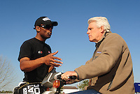 Mar. 13, 2011; Gainesville, FL, USA; NHRA funny car driver Jim Head (right) talks with top fuel dragster driver Antron Brown during the Gatornationals at Gainesville Raceway. Mandatory Credit: Mark J. Rebilas-