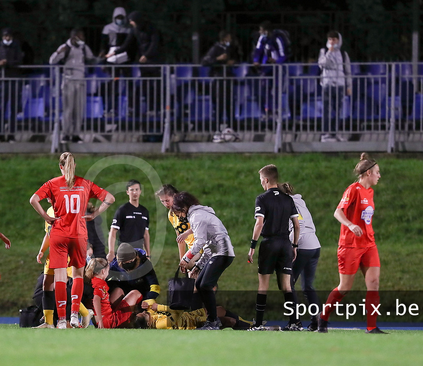 Woluwe's Estelle Peron (45)(in red)  and <br /> Standard's Lola Wajnblum (11) injured on the ground during a female soccer game between FC Femina WS Woluwe and Standard Femina de Liege on the fourth match day of the 2020 - 2021 season of Belgian Womens Super League , Friday 8th of October 2020  in Liege , Belgium . PHOTO SPORTPIX.BE | SPP | SEVIL OKTEM