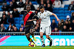 Daniel Ceballos Fernandez, D Ceballos, of Real Madrid (R) fights for the ball with Luis Advincula of Rayo Vallecano during the La Liga 2018-19 match between Real Madrid and Rayo Vallencano at Estadio Santiago Bernabeu on December 15 2018 in Madrid, Spain. Photo by Diego Souto / Power Sport Images