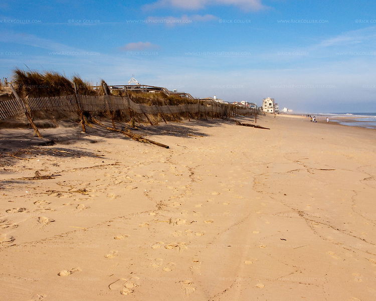 A sand fence still stands, uselessly, several feet above the level of the beach after the November, 2009, nor'easter at Rehoboth Beach, Delaware, USA.