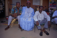 Zinder, Niger, West Africa.  Hausa Men in Traditional and Modern Western Clothes.