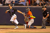 University of Washington Huskies Kaiser Weiss (12) follows through on his swing against the Cal State Fullerton Titans at Goodwin Field on June 10, 2018 in Fullerton, California. The Huskies defeated the Titans 6-5. (Donn Parris/Four Seam Images via AP Images)