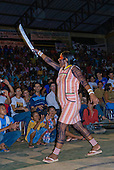 Altamira, Brazil. Encontro Xingu protest meeting about the proposed Belo Monte hydroeletric dam and other dams on the Xingu river and its tributaries. Tuira Kayapo speaking, with her machete aloft.