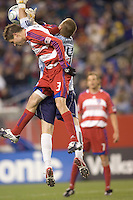 New England Revolution goalkeeper Brad Knighton (24) grabs ball before FC Dallas defender Drew Moor (3) can head it. The New England Revolution defeated FC Dallas, 2-1, at Gillette Stadium on April 4, 2009. Photo by Andrew Katsampes /isiphotos.com