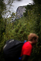 Competitor Espen Fadnes walks through a forest on their way to the mountain top. World BASE Race is held in Innfjorden, Norway, where BASE jumpers in wingsuits compete in flying down the mountain. The winner is called the World's Fastest Flying Human Being..©Fredrik Naumann/Felix Features.