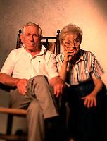 Portrait of an older couple sitting together. Elderly.