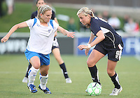 Allie Long #9 of the Washington Freedom tries to get away from Amy Rodriguez #8 of the Boston Breakers during a WPS match at the Maryland Soccerplex, in Boyd's, Maryland, on April 18 2009. Breakers won the match 3-1.