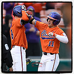 Right fielder Michael Green (11) of the Clemson Tigers is greeted by teammates after hitting a home run in a game against the South Alabama Jaguars on Opening Day, Friday, February 15, 2019, at Doug Kingsmore Stadium in Clemson, South Carolina. Clemson won, 6-2. (Tom Priddy/Four Seam Images)