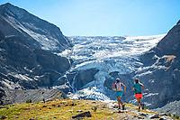 Trail running in the Turtmanntal, on the way to the Turtmannhütte during the Via Valais, a multi-day trail running tour connecting Verbier with Zermatt, Switzerland.