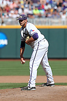 Riley Ferrell #12 of the TCU Horned Frogs pitches during Game 3 of the 2014 Men's College World Series between the Texas Tech Red Raiders and TCU Horned Frogs at TD Ameritrade Park on June 15, 2014 in Omaha, Nebraska. (Brace Hemmelgarn/Four Seam Images)