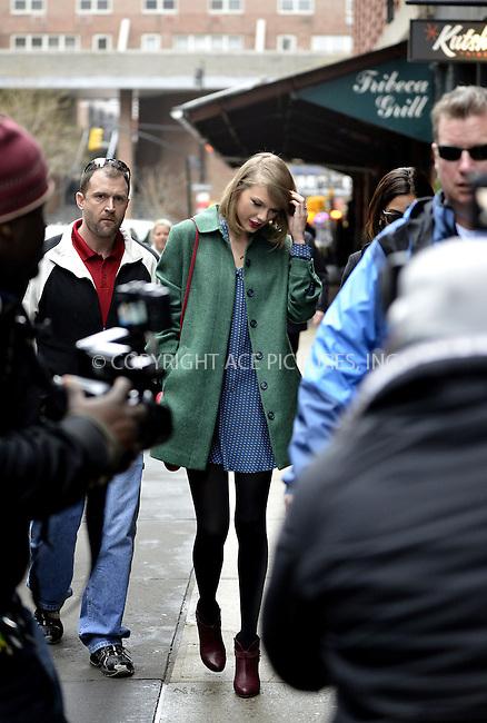 WWW.ACEPIXS.COM<br /> <br /> March 28 2014, New York City<br /> <br /> Taylor Swift walks back to her Tribeca apartment on March 28 2014 in New York City<br /> <br /> By Line: Curtis Means/ACE Pictures<br /> <br /> <br /> ACE Pictures, Inc.<br /> tel: 646 769 0430<br /> Email: info@acepixs.com<br /> www.acepixs.com