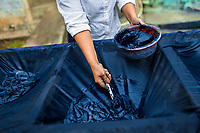 A Salvadoran farm worker collects indigo paste processed at the semi-industrial manufacture near San Miguel, El Salvador, 12 November 2016. For centuries, indigo, a natural deep blue dye extracted from the leaves of tropical plants (Indigofera), has been known to the native indigenous inhabitants of Central America who used the blue tincture to color their fabrics and pottery. Although demand for natural indigo dropped significantly at the end of 19th century when a synthetic indigo was firstly introduced, commercialization of natural indigo has risen again during the last decades. Small-scale indigo farms, processing the crop on sustainable and ecological basis, are growing throughout the country, returning El Salvador to the place of the main natural indigo producer in Latin America.