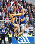Cathal Malone of Clare in action against Padraig Maher of Tipperary during their quarter final at Pairc Ui Chaoimh. Photograph by John Kelly.