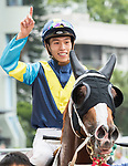 Jockey C Y Ho riding Jolly Gene pose for photos after winning the Race 2 - Southern Ocean Handicap  on 07 May 2017, at the Sha Tin Racecourse  in Hong Kong, China. Photo by Chris Wong / Power Sport Images