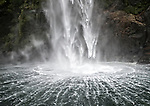 The bottom of a waterfall in Milford Sound on a rainy afternoon