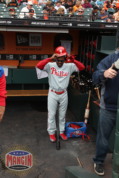 SAN FRANCISCO, CA - MAY 8:  Jimmy Rollins #11 of the Philadelphia Phillies gets ready in the dugout before the game against the San Francisco Giants at AT&T Park on Wednesday, May 8, 2013 in San Francisco, California. Photo by Brad Mangin
