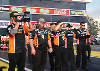 Feb 7, 2014; Pomona, CA, USA; Crew members watch as NHRA top fuel dragster driver Clay Millican stages ready to race during qualifying for the Winternationals at Auto Club Raceway at Pomona. Mandatory Credit: Mark J. Rebilas-