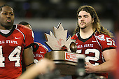 January 5th, 2008:  Ball State lineman Dan Gerberry (52) and defensive end Cortlan Booker (44) accept the runner up trophy after the International Bowl at the Rogers Centre in Toronto, Ontario Canada...Rutgers defeated Ball State 52-30.  ..Photo By:  Mike Janes Photography