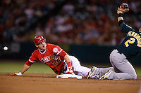 Mike Trout #27 of the Los Angeles Angels steals second base as he beats the throw to Cliff Pennington #2 of the Oakland Athletics at Angel Stadium on September 10, 2012 in Anaheim, California. Oakland defeated Los Angeles 3-1. (Larry Goren/Four Seam Images)