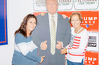 Women pose with a cardboard cutout of US president Donald Trump during a Trump campaign office opening party in Salem, New Hampshire, on Fri., Sept. 18, 2020. Former 2016 Trump campaign manager and current 2020 Trump campaign senior advisor Corey Lewandowski, lives in nearby Windham, NH, spoke at the event, which also doubled as a surprise birthday celebration for Lewandowski.
