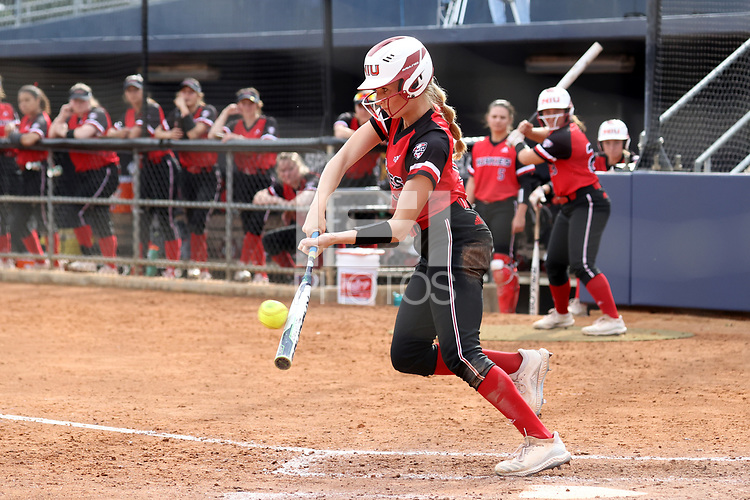 GREENSBORO, NC - MARCH 11: Kara Apato #16 of Northern Illinois University hits the ball during a game between Northern Illinois and UNC Greensboro at UNCG Softball Stadium on March 11, 2020 in Greensboro, North Carolina.