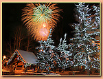 Photoshop. Fireworks and some trees added.<br /> Vail Fireworks at Vail Village, Colorado.