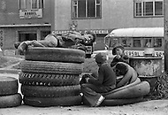 Childen working in tire repair shop in Bogota, Colombia - Child labor as seen around the world between 1979 and 1980 – Photographer Jean Pierre Laffont, touched by the suffering of child workers, chronicled their plight in 12 countries over the course of one year.  Laffont was awarded The World Press Award and Madeline Ross Award among many others for his work.