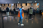 BROOKLYN, NY — OCTOBER 24, 2020:  A person wearing a face mask and carrying a folding chair waits in line to vote inside the Barclay's Center, during the first day of early voting in the U.S. Presidential Election, on October 24, 2020 in Brooklyn, NY.  Photograph by Michael Nagle