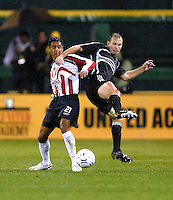 DC United defender Bryan Namoff (26) jumps to defend the play against CD Guadalajara forward (21) Sergio Mendez in the first leg of the 2007 CONCACAF Champions' Cup Semifinal match between DC United and CD Chivas from Guadalajara. DC United tied Chivas 1-1 on March 15, 2007 at RFK Stadium in Washington DC.
