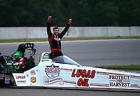 Aug 17, 2014; Brainerd, MN, USA; NHRA top fuel driver Morgan Lucas celebrates after winning the Lucas Oil Nationals at Brainerd International Raceway. Mandatory Credit: Mark J. Rebilas-USA TODAY Sports
