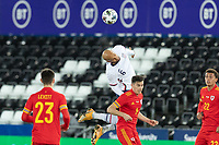 SWANSEA, WALES - NOVEMBER 12: John Brooks #6 of the United State wins the header during a game between Wales and USMNT at Liberty Stadium on November 12, 2020 in Swansea, Wales.