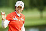 South Korean's Eun-Hee Ji waves to the crowd after making her putt on the second hole during Round 3 at the LPGA Championship at Locust Hill Country Club in Pittsford, NY on June 9, 2013