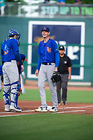 Midland RockHounds pitcher Brian Howard (23) (right) laughs with catcher Jonah Heim (13) after waiting for a ball to roll foul on May 4, 2019, at Arvest Ballpark in Springdale, Arkansas. (Jason Ivester/Four Seam Images)