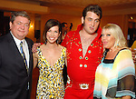Jon Iszard, Roseann Rogers, Justin Dollar as Elvis and Lara Bell at the Health Museum Casino Party at the Four Seasons Hotel Saturday Aug. 15, 2009.(Dave Rossman/For the Chronicle)