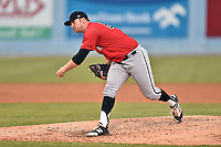 Kannapolis Intimidators starting pitcher Johnathan Frebis (26) delivers a pitch during a game against the Asheville Tourists at McCormick Field on May 19, 2016 in Asheville, North Carolina. The Intimidators defeated the Tourists 10-7. (Tony Farlow/Four Seam Images)