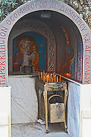 Small street side chapel with painting of the madonna. Thessaloniki, Macedonia, Greece