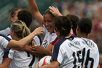 USWNT's Abby Wambach (20,) celebrates with teammates after scoring her 100th career goal in the second half. The U.S. Women's National Team defeated Canada 1-0 in a friendly match at Marina Auto Stadium in Rochester, NY on July 19, 2009.