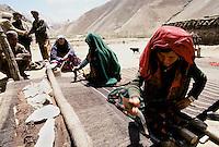 Two womans working on a kilim carpet at  Sabznaw village between Yakawlang an Pandjab. Hazarajat, Afghanistan.