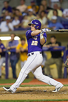 LSU Tigers designated hitter Kade Scivicque #22 follows through on his swing during the Southeastern Conference baseball game against the Georgia Bulldogs on March 22, 2014 at Alex Box Stadium in Baton Rouge, La. The Tigers defeated the Bulldogs 2-1. (Andrew Woolley/Four Seam Images)